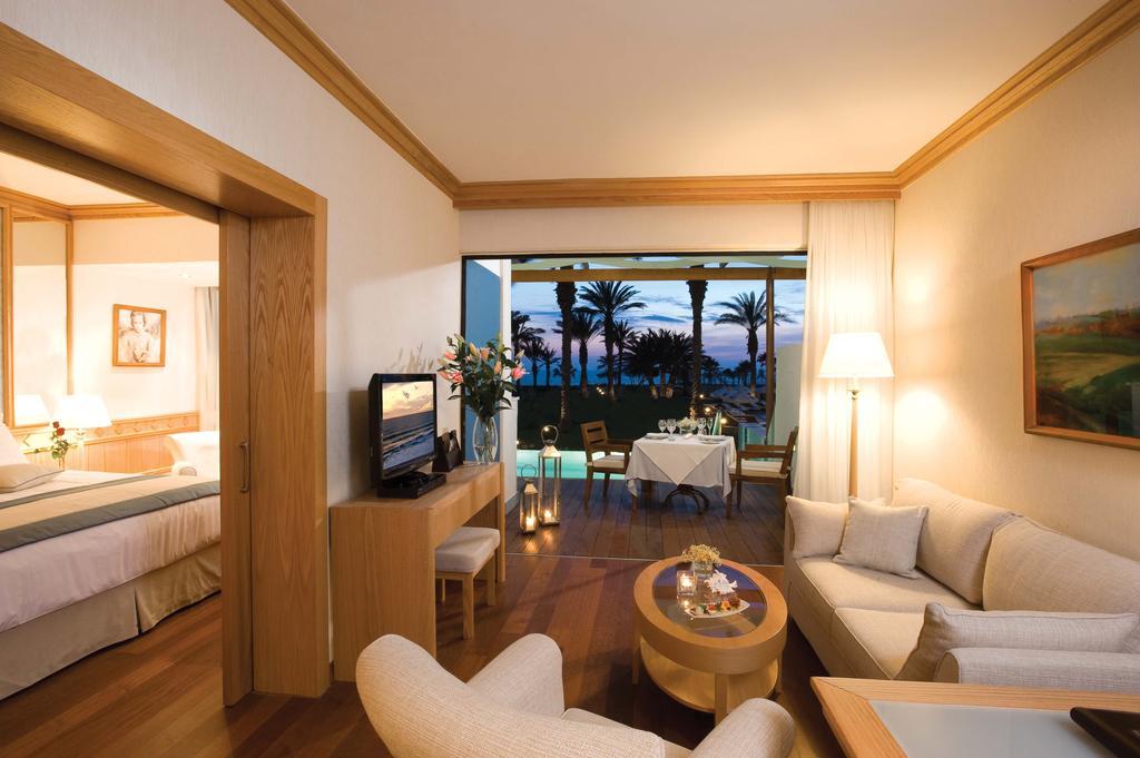 Фото отеля Constantinou Bros Asimina Suites Hotel (ex. Constantinou Bros Pioneer Beach Hotel)