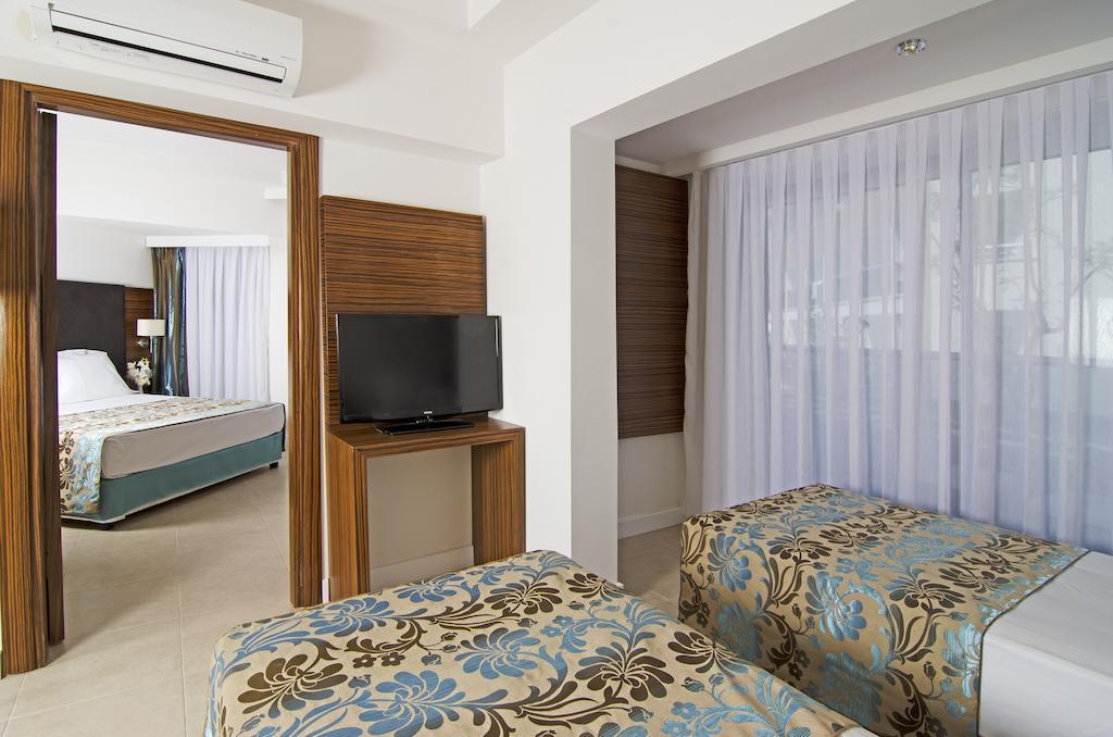 Отдых в отеле Palm Wings Beach Resort & Spa Кушадасы Турция