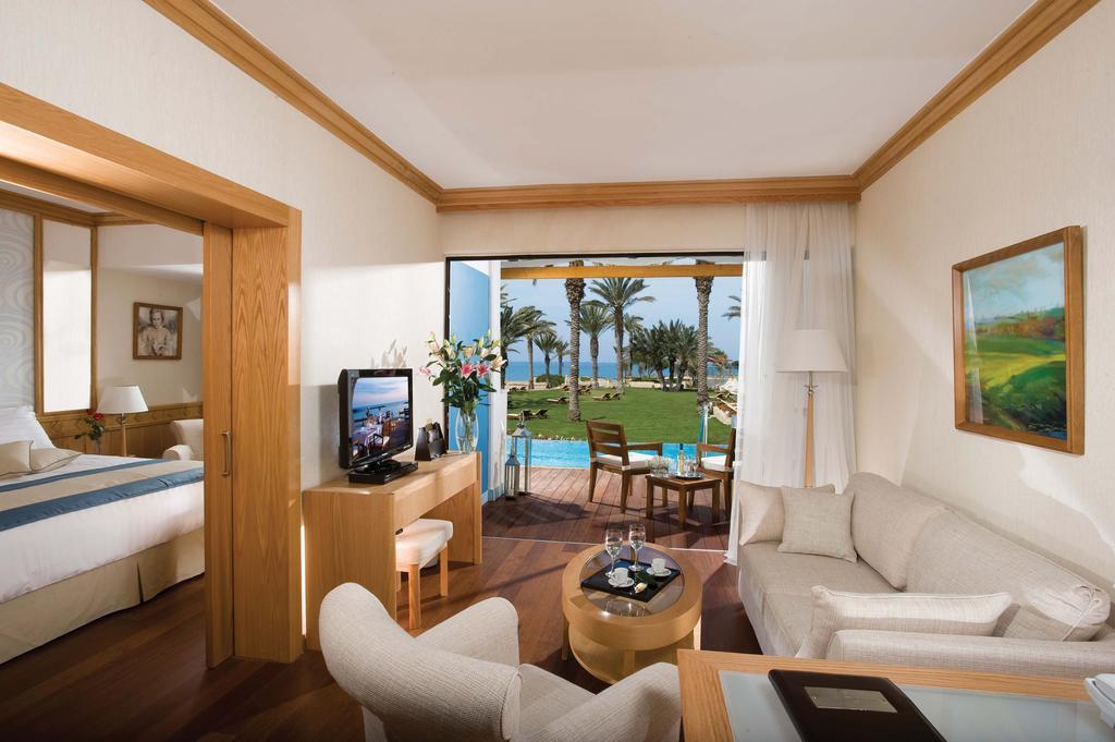 Constantinou Bros Asimina Suites Hotel (ex. Constantinou Bros Pioneer Beach Hotel), Пафос, Кипр, фотографии туров
